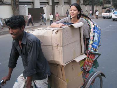 Hard at work, bringing supplies home via rickshaw. Dhaka, Bangladesh. Photo: Austin Miller.
