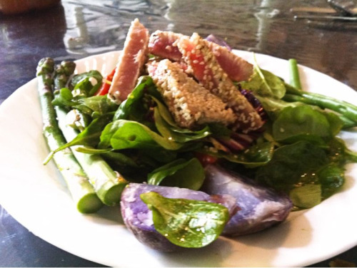 Nicoise Salad with seared tuna, purple potatoes, asparagus, green beans and a mâché spinach salad mix.