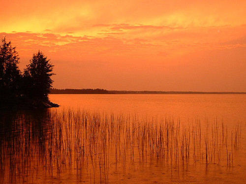 Sunset over lake in Finland by strzelec on Flickr.