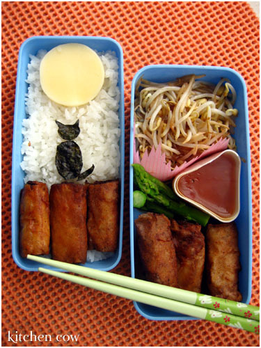 Bento sasaq:  Bento 149: Lumpiang Shanghai Over the Moon! by kaoko on Flickr. Bento 149: Lumpiang Shanghai Over the Moon! When the moon hits your eye like a big pizza pie, that's amoreeee~~~ For more info about this moontastic bento, read on at:  www.kitchencow.com/2007/08/08/lumpiang-shanghai-bento-ove…