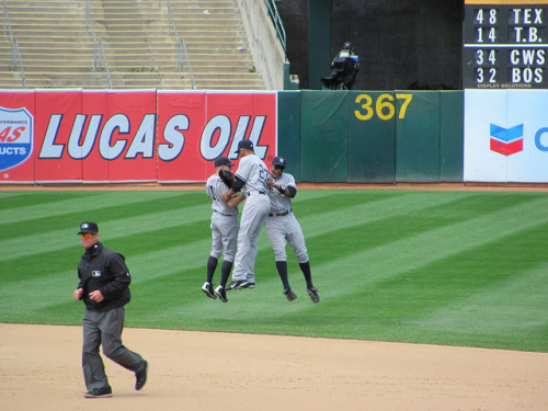 amandarykoff:  Victory Jump! on Flickr. Brett Gardner, Chris Dickerson and Curtis Granderson do the Victory Jump after the final out of the Yankees 4-2 win over Oakland. June 1, 2011.