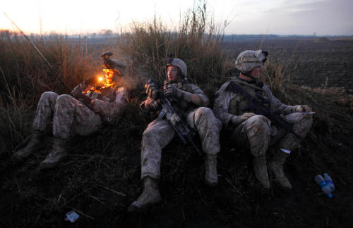 "Marines from the 2nd Battalion, 2nd Marines ""Warlords"" rest during an operation to hunt for insurgents."