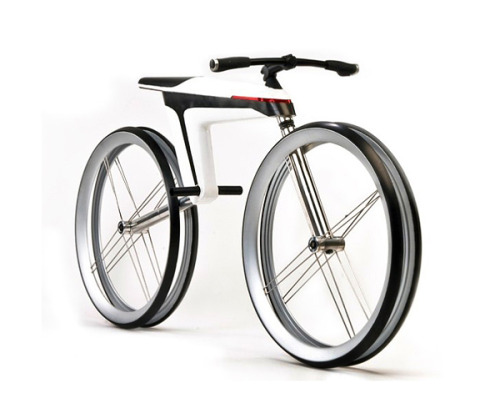 rozanes:  ReCraft Your Ride: Carbon Fiber Bike HMK 561 Unlike of many other concepts electric bicycle concept HMK 561 from Ralf Kittmann took home an iF Design Award for some seriously forward thinking. Cyclists HMK 561 is made of conductive carbon fiber, which is not only an excellent conductor of electricity, but also acts as a capacitor that can store energy. This energy is obtained by converting the mechanical energy into electrical energy in each mobile connection of mechanism. The resulting energy fed to the engine and lights. And there is already a working prototype!