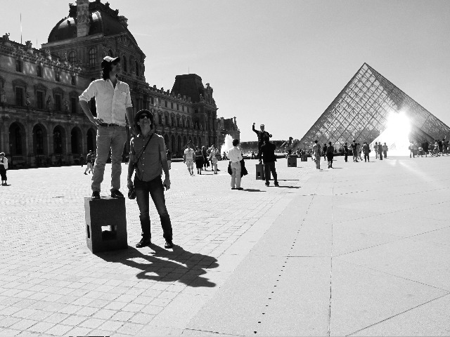 PY and Scott moonlight as living statues at the Louvre on their day off (photo by BKY)
