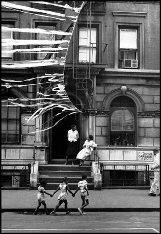 Children walk hand in hand in Harlem, NYC, 1963 Leonard Freed