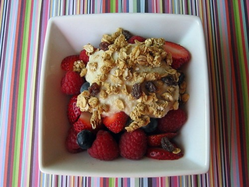 "robotheartrecipes:  Veg Boot Camp Day Twenty-Two: BreakfastBerries with Cashew Cream and GranolaServes 1 I really enjoyed the flavor of this cashew cream. It was earthy, with just the right hint of sweetness from the maple syrup. This mixture made for a great breakfast. Skip the granola and it would also serve well as a dessert.  INGREDIENTS 1/4 cup raw cashews 2 tablespoons water 2 teaspoons maple syrup 1 cup fresh berries 3 tablespoons granola INSTRUCTIONS Step One: In a food processor, purée cashews, water, and maple syrup until smooth. Serve cashew cream over fresh berries and top with granola. Source: Vegetarian Times ""28 Day Veg Boot Camp Mix 'n' Match Meals: Week 4,"" June 2011. View the recipe on VegetarianTimes.com."