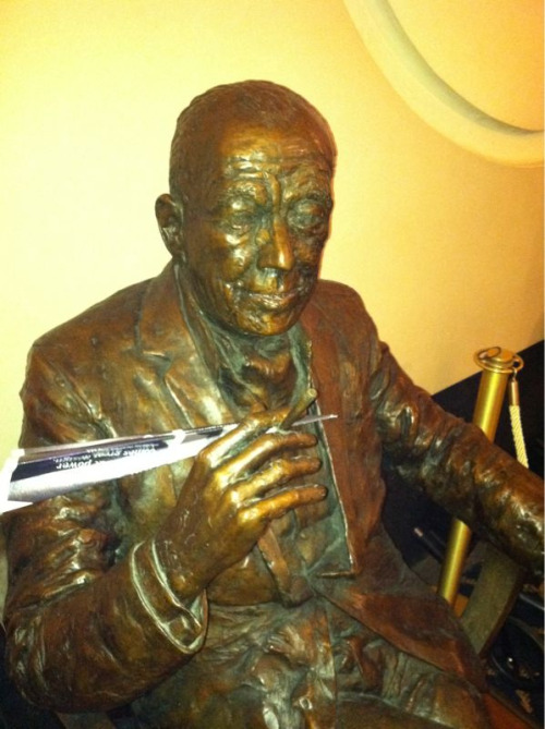 Noel Coward enjoys making paper planes