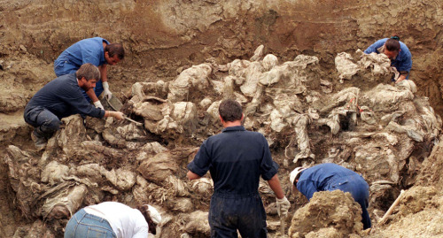radiofreemars:  International forensic experts examine dozens of bodies in a mass grave in the Serb entity of Pilicer, Bosnia, in a Sept. 18, 1996, file photo. They are believed to be some of the 8,000 missing persons who fled Srebrenica in July 1995. Bosnian Serb wartime general Ratko Mladic was arrested in Serbia on May 26, 2011, after being found in a farmhouse owned by a cousin, a police official said. (Kevin Coombs/Reuters)