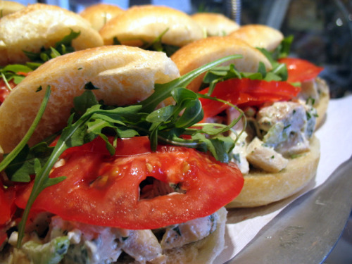 """Chicken salad with ripe tomatoes, parsley and arugula."""