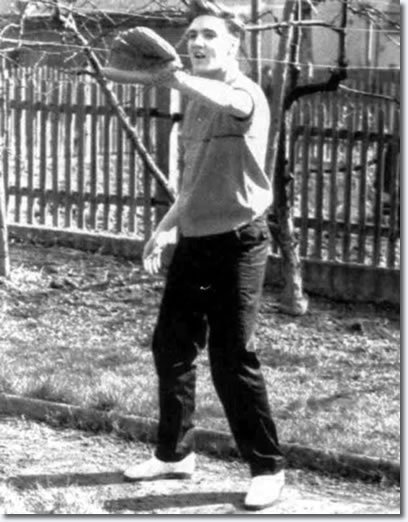 pitchersandpoets:  Elvis playing catch.