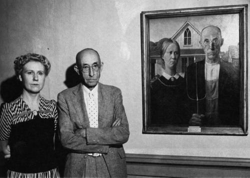 fuckyeah-arthistory:  The sitters for Grant Wood's American Gothic pictured in front of the artwork in 1942. On the left, Wood's sister, Nan Wood Graham; on the right, Wood's dentist, Dr. Bryon McKeeby.