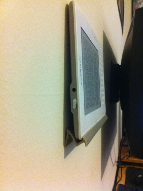 Kindle wall mount out of plastic Scrabble / UpWords tile holder.