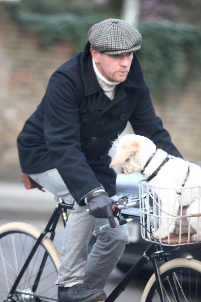 Ewan McGregor in a classic pea coat and newsboy cap.