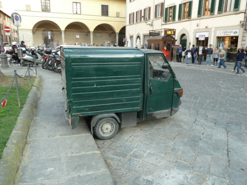 Tiny Italian delivery truck. I guess it might be a bit larger than a smart car. In Florence.
