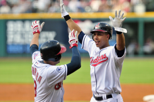 musiquedevie:  Jason Miller/Getty Images Asdrubal Cabrera #13 and Michael Brantley #23 of the Cleveland Indians celebrate after Cabrera hit a two-run home run during the first inning against the Minnesota Twins of the Cleveland Indians and at Progressive Field on June 6, 2011 in Cleveland, Ohio.  Too bad they still lost.  Time to bring back the Windians tonight.