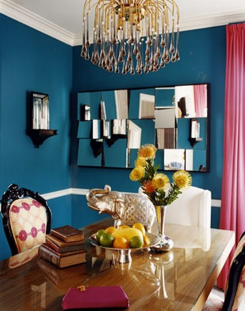Teal walls, hits of fuschia, a gold chandelier - LAYER on the glam in this dining room!