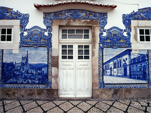 prettymindclutter:  Train station in Aveiro, Portugal. Detail of facade with azulejos.