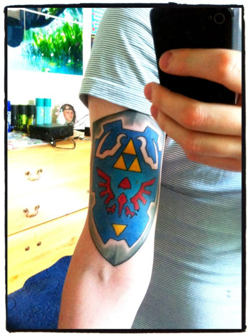 Hylian Shield, done at Ink Vs. Steel in Leeds by Scott Mustapic. And my reason for getting it? Everyone needs a geeky tattoo!