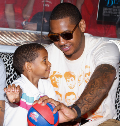 Carmelo Anthony  The New York Knicks very own Carmelo Anthony stops by Vinnie's to grab some off court gear. Here's a picture of Melo in the Brooklyn Alumni shirt by designer Brian Wood and a pair of Mosley Tribes shades.