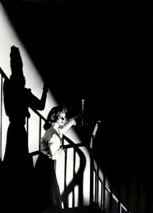"oldhollywood:  Dorothy McGuire in The Spiral Staircase (1945, dir. Robert Siodmak) (via) ""The wind shrieked, as though a flock of witches sailed overhead, racing the moon, which spun through the torn clouds like a silver cannonball, shot into space. Down in the basement, a flickering candle in her hand, she groped amid the mice, the spiders, and the shadows. These shadows shifted before her, sliding along the pale-washed wall, as though to lead the way. Whenever she entered an office, they crouched on the other side of the door, waiting for her. She was nerved up to meet an attack which did not come, but which lurked just around the corner. It was perpetual postponement, which drew her on, deeper and deeper, into the labyrinth."" -Ethel Lina White, The Spiral Staircase (1933)"