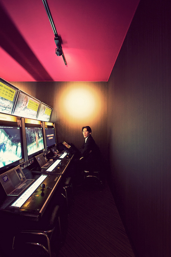 thebinfox:  Club Sega Patron The arcade scene in Tokyo is quite varied, with some being dedicated solely to fighting style games, while others are full of big cabinets that feature the 'card' style games. Most of them are multi-floored buildings that have crazy claw games on the lower levels, with the hardcore arcade games being on the higher floors. Overall it seems that the arcade scene is still going strong in Japan, while herein America it's all but vanished. It seemed like this guy had just got off work and was blowing off some steam.