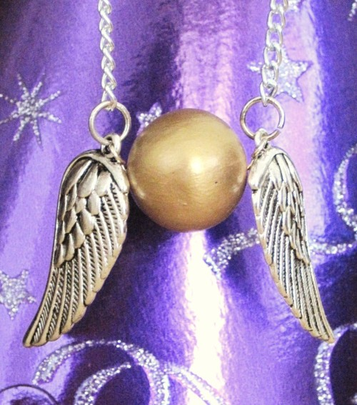 designersof:  Golden Snitch Necklace by Little Love, Inc. You too can carry around a little bit of magic with a golden snitch necklace.  Remember, catching a golden snitch is worth 150 points ;)   —posted by designers of tumblr submit your work here!
