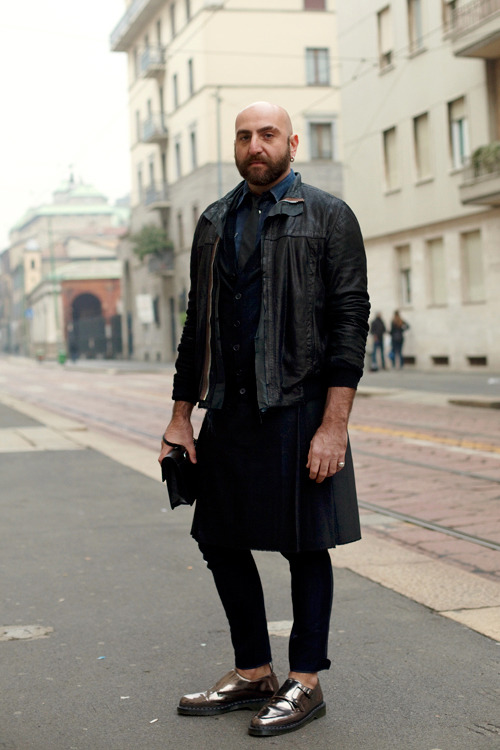 smashingthebinary:  giraffegiraf:  I've been googling men in skirts and pretty much every blogger goes 'but is it acceptable?', 'should we be scared?' I don't understand how these questions can even be asked when these men look so fly. Just look at this man rocking his skirt, purse and silver shoes with a supreme look of arrogance. Basically, I'm in love.  might be a repost. too lazy to check.  what are those shoes even made of is it magic
