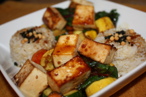 Easy and Delicious Teriyaki Stir Fry w/Tofu  I love stir-frys, so easy, quick and beautiful with seasonal veggies. This one I used squash, chard, bell pepper, and carrots, and tofu. I usually serve a stir-fry with a side of brown rice or soba noodles. I had some leftover teriyaki sauce (not gluten free, but you can definitely buy or make gluten free teriyaki sauce) which I needed to use up and tons of veggies so this dish just came together. I marinated some cut tofu in the teriyaki sauce for about an hour before browning them on a non stick pan with some light oil. While those were browning I cooked the veggies in batches on a skillet with some olive oil and sesame oil (peanut oil would have been best because it is better for higher temperature cooking) until browned. Then all that was left to do was plate the veggies, tofu, and rice topped off with teriyaki sauce. If you don't have teriyaki sauce at home you can skip it and use soy sauce. And of course I always add sriracha!