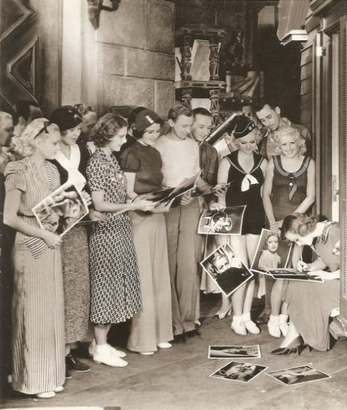 Joan Crawford signs autographs - c. 1930s