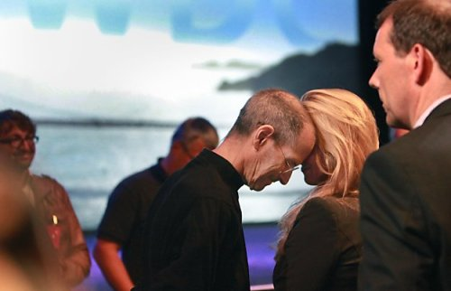 mikehudack:  jryu:    Steve Jobs rests his head against his wife, Laurene Powell Jobs, after delivering the keynote address to the Apple Worldwide Developers Conference at Moscone West on Monday.  SFGate  Human just like the rest of us.  One of the more intimate shots of Steve we've seen. Going up there in his condition has to be tough.