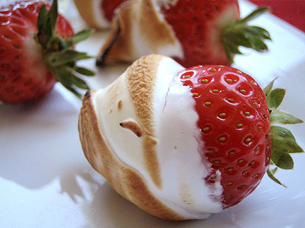 Toasted Marshmellow Strawberries? Instant re-blog.  suitep:  Tortured Strawberries. Strawberries in bruleed marshmallow crème. I'd make these just so I could buy one of those cute little torches.