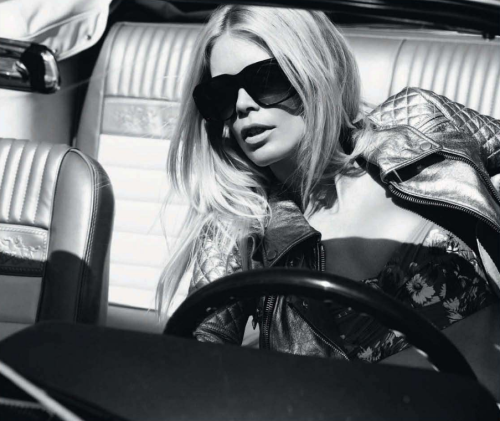 Claudia Schiffer wears Burberry Prorsum in Summer Love 2011 At 41, Claudia Schiffer can still bring her signature Brigitte Bardot sex kitten look that we all fell in love with during the 90s.  From the pages of Harper's Bazaar UK July 2011, Summer 2011 is brought to us with 70s vintage inspiration. This look:  Easy Rider: add a masculine edge to a pretty print with sleep, metallic leather Burberry Prorsum silver metallic leather biker jacket, Dolce & Gabbana grey and mustard elasticated cotton bikini top, Celine sunglasses See the complete photo shoot of Claudia Schiffer in Harper's Bazaar UK July 2011