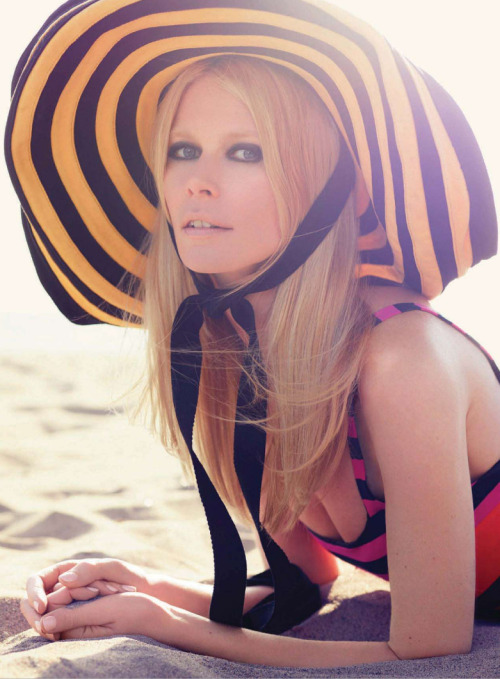 Claudia Schiffer wears Prada in Summer Love 2011 At 41, Claudia Schiffer can still bring her signature Brigitte Bardot sex kitten look that we all fell in love with during the 90s.  From the pages of Harper's Bazaar UK July 2011, Summer 2011 is brought to us with 70s vintage inspiration. This look: Prada cotton striped dress & cotton sun hat See the complete photo shoot of Claudia Schiffer in Harper's Bazaar UK July 2011