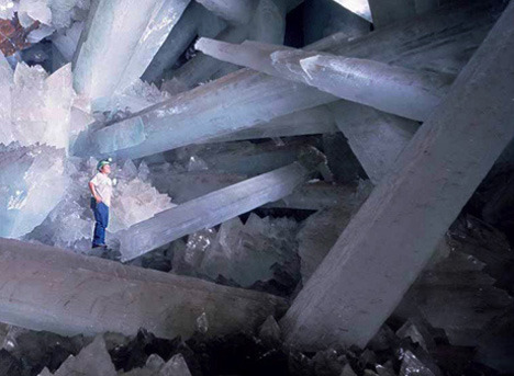 gandalfthewhite:  Cave of Crystals, Mexico Crystals have already been popular among the people especially in their  pricy forms. No surprise that the cave that has a temperature of almost  60 degrees and 100 percent humidity of air makes the area almost  inaccessible to man, but  a lot of people are ready to go  not only to  such sacrifices to look at the giant crystals of gypsum. Crystals that  were discovered here in 2000 are the largest on Earth; the largest  specimens reach 11 meters in length and a half in circumference and  weigh over 50 tons.  Amazing