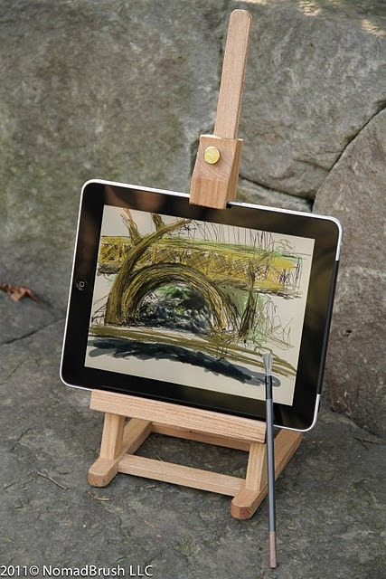 evokecreative:  NOW I need an ipad. The Nomad Brush lets you paint on your screen with a real brush instead of using your finger. Brilliant. Now if they can only replicate the wonderful smell of paint!  This is probably the first app I've seen that makes me want to buy an iPad.  Great use of the touch interface of the iOS.