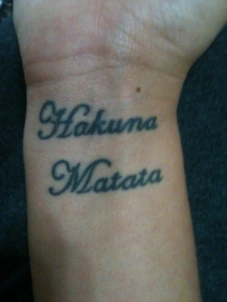 fuckyeahdisneytattoos:  Hakuna Matata on my right wrist. :) I plan on getting Pumbaa eventually.
