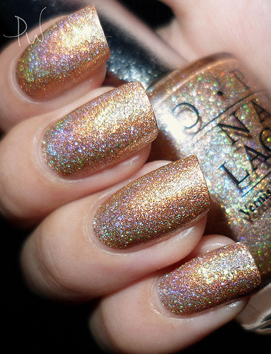prettyproject:  nailvanities:  OPI: DS Shimmer (JP) (by Prwnkl)  Ooohh! Shinny! :)  This makes me want to give OPI holos another chance.