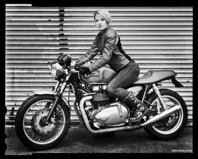 "Another from the series of me on the 2005 Triumph Thruxton 900. Photo by Giles Clement (www.gilesclement.com). The way I met Giles is quite awesome, really. Months ago, probably near the end of 2010, I started a group for lady riders on PNW Riders (a forum I use for Motorcyclists in the Pacific Northwest). I went looking for a photo to use for the group avatar, and googled female motorcyclists or something to that effect. One of the first images to pop up was this shot of Maureen and the 1962 BSA Lightning. I instantly fell in love, and used it as the group photo. As it often is with the internet, I had no idea who the photographer was.  Later, in January, I started MotoLady. I then posted two more photos I found and asked readers if they knew who the photographer was. Very soon after I received two tips linking me to Giles' flickr photostream. Turns out, he lives in Astoria Oregon. A coastal town a couple hours away from where I live in Portland.  At this time, I promptly wrote Giles something to the effect of, ""HOLY CRAP I LOVE YOUR WORK WE HAVE TO SHOOT SOMETHING."" And a few months later, here we are.   Since my motorcycles are both being fixed, and Giles is doing a British Bike series, we borrowed my co-worker Marc Friedman's beautiful Triumph Thruxton.  Behold, the power of the internet."