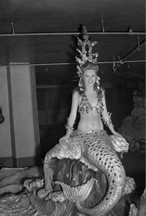 "allmermaids:  Young Circus Woman Dressed as a Mermaid. Lovely Natalie Sullivan, of Sarasota, Florida, makes a realistic and breathtaking Mermaid, as she enacts her role in the Ringling Brothers, Barnum and Bailey Circus, now in session at Madison Square Garden. The Mermaid appears in ""Panto's Dream,"" one of the pretty features of the circus."