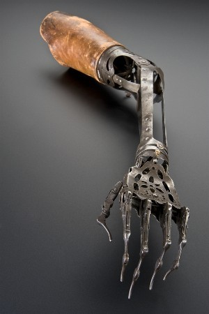 yorsworld:  deformutilation:  Prosthetic Arm, circa 1850 - 1910 Made from steel and brass, this unusual prosthetic arm articulates in a number of ways. The elbow joint can be moved by releasing a spring, whereas the top joint of the wrist allows a degree of rotation and an up-and-down motion. The fingers can also curl up and straighten out. The leather upper arm piece is used to fix the prosthesis to the remaining upper arm.  All I can think is Terminator 2