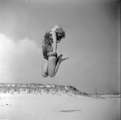 Dancer Ann Argent practices her routine on the beach, 1950  from getty