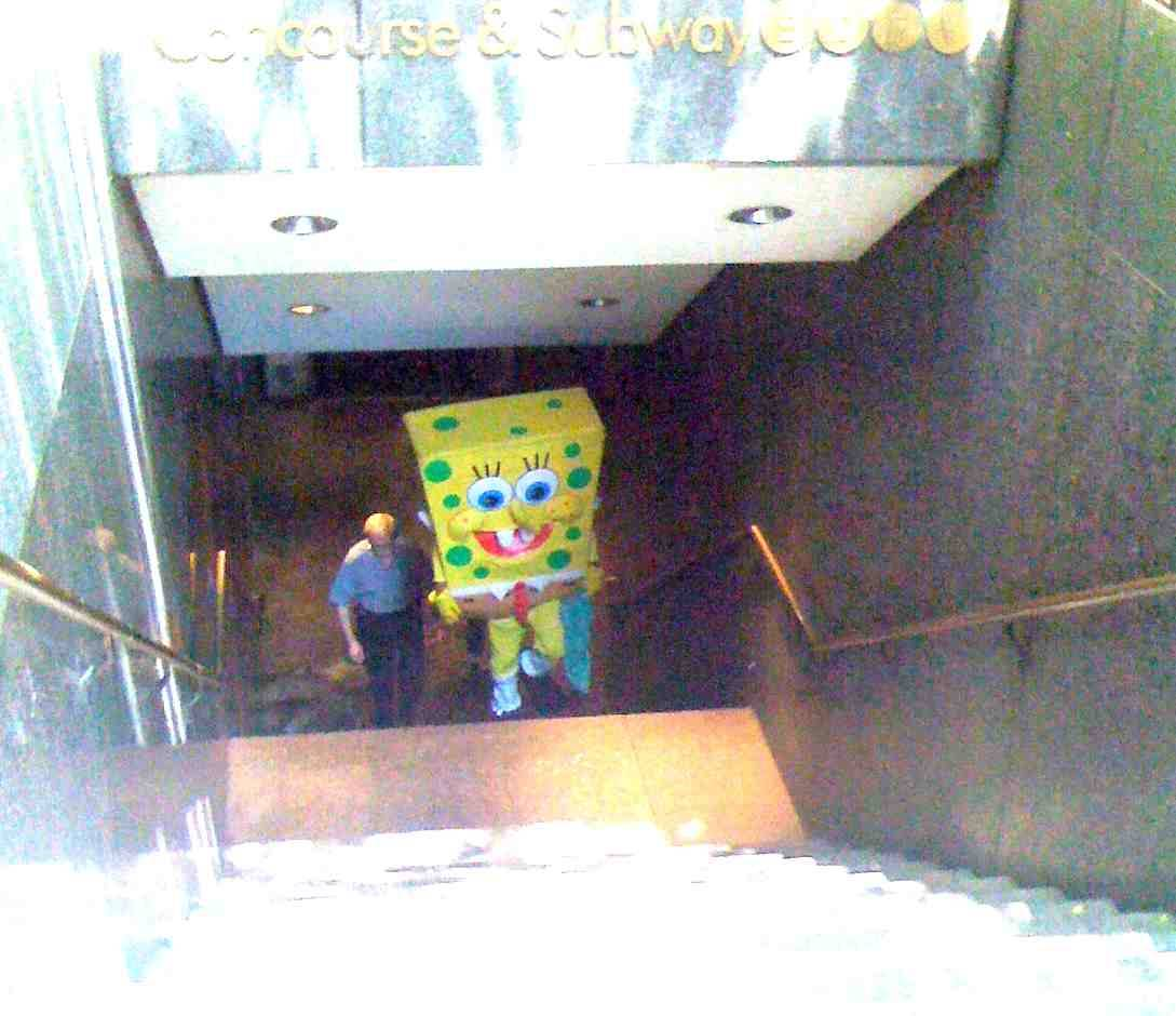 "Sponge Bob Busted ! so i'm on the F train the other day and this fkn guy bumps into me and tries to run the broken watch scam on me. you know what i mean… he shows me some bullshitty watch on his wrist and he's like… ""yo. you broke my fuckin' watch! you owe me 500 dollars."" he started getting real close and all in my personal space. before i could react to what he was saying i was like ""oh shit! i know this dude. wait.. wait.. uuhhh…"" then the train kinda stopped quick and he fell back against the doors and i was like ""fuck you Sponge Bob"". he kinda shrugged it off and walked to the next car. and i'm all , man that was odd. nobody else seemed to notice. anyways, when i got off at my stop (47th+6th)  i saw some kind of scuffle and then a crowd grew. i guess Sponge Bob tried to steal somebody's blackberry or something and got busted by an undercover cop. i waited at the top of the stairs for him cause i thought you guys would like the picture of the Sponge Bob perp walk. you're welcome. adam"