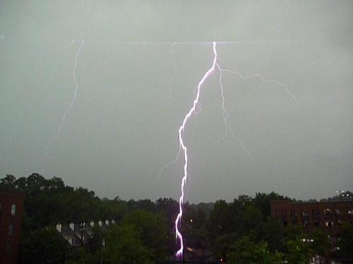 HOLY HELL! From my window about 30 minutes ago. It's a screen cap from while I was shooting video from my window here in Northampton, Mass. What a dumbass I am. And what's with the straight line at the top???  UPDATE: Here's the video. Sick bolts are at the :11.9 to :12.0 second mark. http://www.youtube.com/watch?v=VmNP6OpEJps