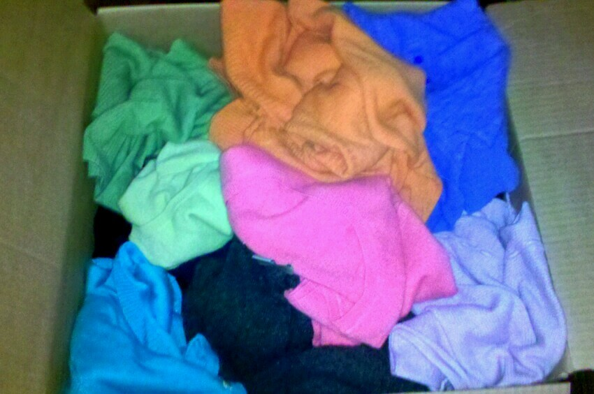 The Averse Universe: One of many boxes full of brightly colored cashmere whatevers. Must be getting close to the shoes! Actually, there may be some things I want out of this box!! (Sherry I swear they were all folded when this was packed)