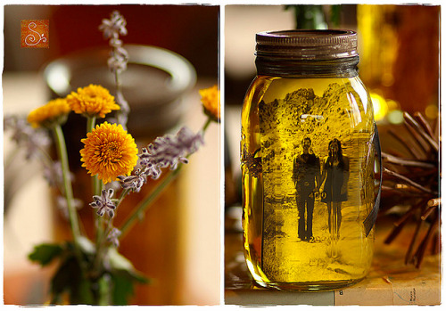 craftacular:  I've seen photos placed into vintage jars create a terrific display, but this olive oil-suspended photo in a mason jar gives a completely different, yet eerily wonderful effect. (via)