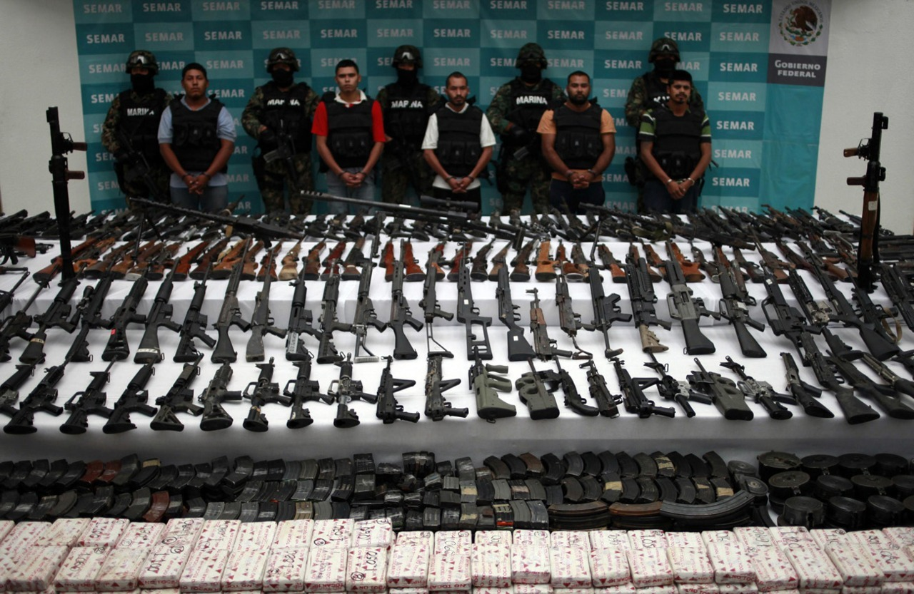 Photos of the daySuspects are lined up as weapons are displayed to the media by the Mexican Navy in Mexico City, June 9, 2011. According to the Mexican Navy over 441 pounds of cocaine were seized in an operation against the Zetas drug cartel in Coahuila and Nuevo Leon in the north of Mexico. (Jorge Dan Lopez/Reuters)