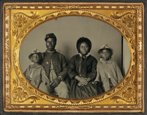 Unidentified black Union soldier and his family. (Not sure if the little girls are twins or just have similar taste in bonnets.)