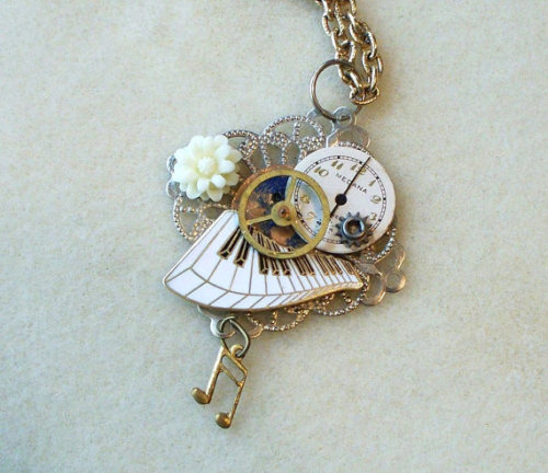 Steampunk Piano Clockwork necklace This is beautiful and I love the piano keys on the pendant.