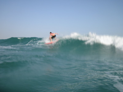 One of the Persian Gulf's finest on a blurry right-hander this morning; June 11 2011 a few minutes after Sunrise at Sunset Beach