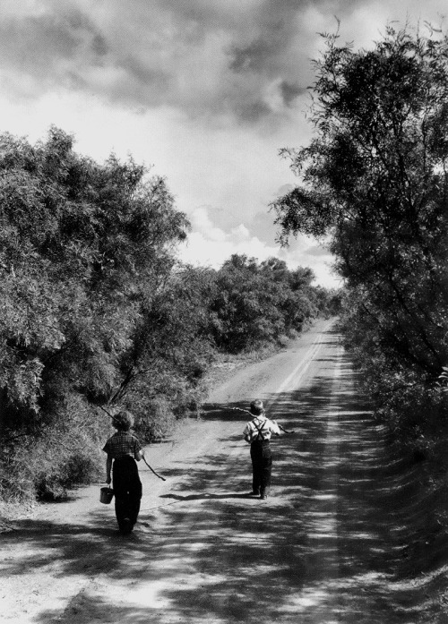 m3zzaluna:  two children walking down a dirt road going fishing on a summer day, tx, us, june, 1952 photo by john dominis